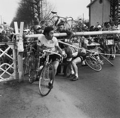 cadenced: Eddy Merckx going under the barrier at the 1974 Tour de France.