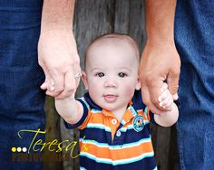 6 month old...holding parents hands