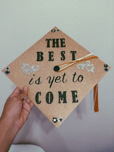 The best is yet to come graduation cap:  Gold glitter scrapbook paper and stickers purchased at Michaels
