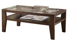 """The Deagan Coffee Table from Ashley Furniture HomeStore (AFHS.com). The rich finish and angular contemporary design of the """"Deagan"""" accent table collection come together to create furniture that fits flawlessly into the decor of any living environment."""