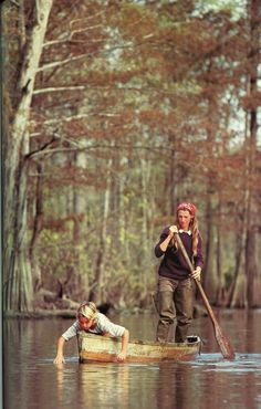 I love everything about this. Child in a canoe, mama in waders, cranberry sweater, the woods, oy vey.