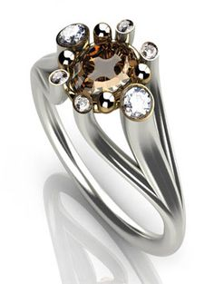 The coolest ring I've seen in a long time. It's almost alien! Www.designer-engagement-rings.co.uk - atelier