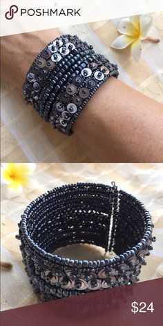 *Gorgeous sequined boho cuff Handmade in bali, strung from strands of memory wire with gorgeous seed beads and sequin layers. Features open back cuff for a universal fit. Gorgeous statement bracelet for winter resort 2016! handmade Jewelry Bracelets
