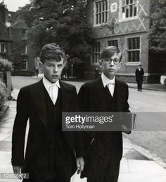 Stock Photo : Eton College schoolboys in England, 1951. Eton is the most exclusive boys public school (which, in Great Britain, refers to a privately-funded and independent school) in England. It was founded in 1440 by Henry VI and is located in Eton, Berkshire.