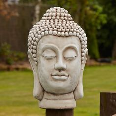Buddha Head Stone Bust Statue Large Garden Ornament. Buy now at http://www.statuesandsculptures.co.uk/large-garden-ornaments-buddha-head-stone-bust-statue
