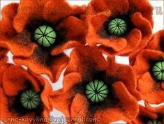 Red poppy tutorial.  I don't know if this is needle felted or if they used wool felt, but would be pretty as a brooch.