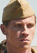 Garrett Hedlund in the Unbroken movie as Commander John Fitzgerald. See 'Unbroken: History vs. Hollywood' - http://www.historyvshollywood.com/reelfaces/unbroken/