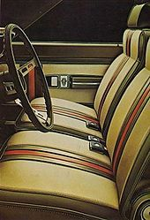 """Aldo Gucci went into agreements with American Motors Corporation (AMC) merging with Gucci AMC Hornet. In October 1971-1973 Hornet compact """"Sportabout"""" station wagons offered a special luxury trim package.  Gucci versions came had a signature red and green trim color on upholstered seating/interior door panels. The Gucci crest was inside front door panels/front fenders.  Exterior colors were Snow White, Hunter or Grasshopper Green, and Yucan Tan."""