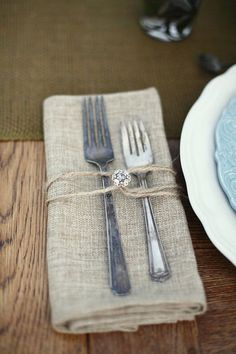 Natural linens with a touch of bling.; Pretty and cheap way to dress up silverware setting