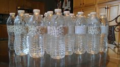 Easy diy water bottle labels for wedding welcome bags for out of town guests. Scrapbook paper, paper cutter and double-sided tape.