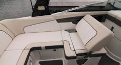 Sea Ray 240 Sundeck Outboard: The portside observer's seat has a flip-back seatback that converts from forward facing to aft facing with minimal effort.