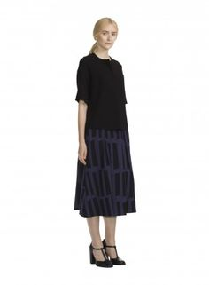 """Kurvi skirt Made of viscose jersey with a touch of elastane that adds a little flexibility, this pleated A-line skirt features the new Iso Lastu print. It has a hidden elasticized waistline with a concealed rear zip closure, two front and back inverted pleats, and side slit pockets."" (quote) Finnish design by Marimekko © Marimekko Finnish design by Marimekko via us.marimekko.com"