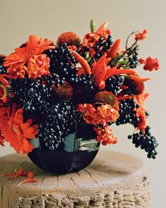 Fall flower arrangement. Gorgeous! Love the vibrant burnt orange colors & midnight hues.