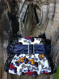 NASCAR print in this great purse with black and navy.  Lucydesigns on Facebook !!! Purse Patterns, Black And Navy, Nascar, Purses And Bags, Facebook, Handmade, Ideas, Hand Made, Craft