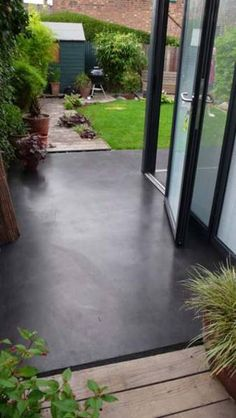 reclaimed hardwood floors inside - french doors (in more of an english cottage style) opening onto polished concrete patio