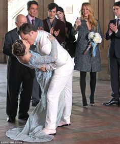 That's romance: Chuck bends his bride back for show-stopping kiss. Love the dress!