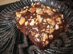 When I was growing up my mom made this cake but she called it Neighborhood Cake.  It is such an easy & chocolaty good.  I like it with nuts.  It is great to take to a potluck or picnic.  When it cools store it in the fridge.  Personally I like it warm!!