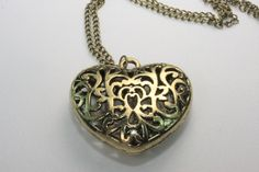 ANA18549:              Heart of Love Bronze Hollow Heart Pendant with Bronze like chain.  About the picture: There may be a slight difference of color between the picture and the actual ring because of brightness.$9.00