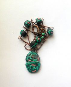 Green abstract polymer clay pendant necklace, purple, golden colour beads