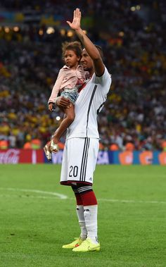 Jerome Boateng of Germany celebrates with his daughter after defeating Argentina 1-0 in extra time during the 2014 FIFA World Cup Brazil Final match between Germany and Argentina at Maracana on July 13, 2014 in Rio de Janeiro, Brazil.