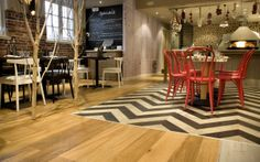 VINYL FLOORING TYPES - INTERESTING MIX OF FLOOR TONES WITH RED CHAIRS