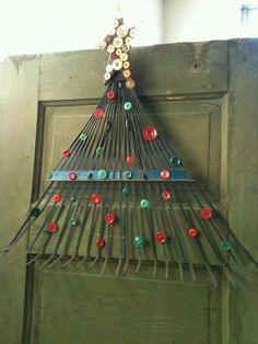 Garden rake and buttons repurposed for a cool Christmas craft.