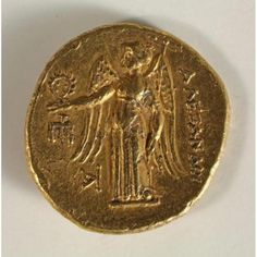Stater: Obverse, Head of Pallas Athena; Reverse, Standing Nike Holding a Naval Mast in Left Hand and Wreath in Right Hand ca. Gold American Eagle, Gold And Silver Coins, Coin Worth, Pirate Treasure, Old Coins, Left Handed, Seals, Art Museum, Mythology