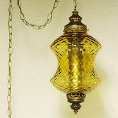 Vintage hanging light - hanging lamp - swag lamp - yellow/gold globe - spool shape - chain cord  - pendant light. $47.50, via Etsy.