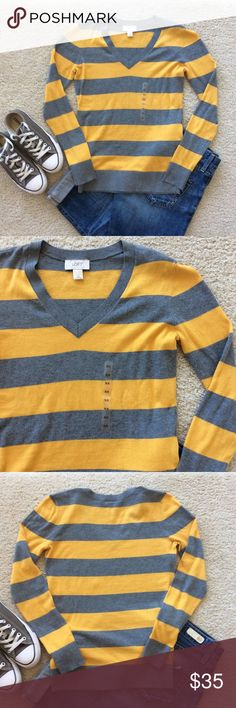 "LOFT Striped Sweater LOFT yellow and grey striped pullover sweater. Super cute and casual. V neck. Long sleeves. Lighter weight, great for Spring. Laying flat approx 24"" shoulder to hem, approx 16.5"" pit to pit. 100% cotton. Size XS. NWOT, never worn. #862 LOFT Sweaters V-Necks"