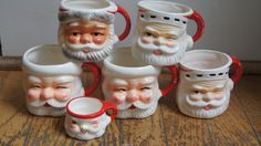 Six (6) santa coffee mugs marked Japan. Reproductions just feautured in Pottery Barn.. $45.00, via Etsy.