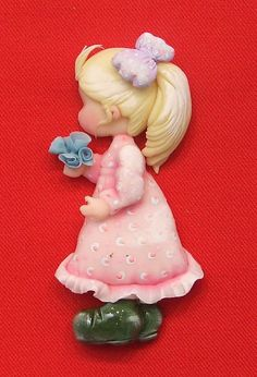 Little girl with flowers - side view.  Great for side or top of cake