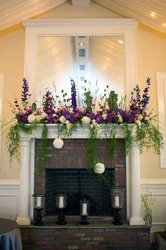 Blossom Artistry, Fireplace mantle decorated with purple, pink and white flowers