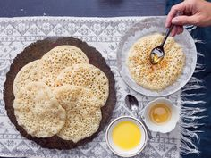 Unlike French crêpes, these chewy, yeasted crêpes are cooked only on one side until bubbles set on the surface, giving them the mottled appearance from which they take their name.