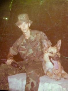 Unknown American soldier and his dog. Viet Nam.