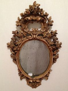 #Rococo #mirror in molded and carved #giltwood with decorations of foliage and shells. #18thcentury. For sale on #Proantic by L'autre Temps.