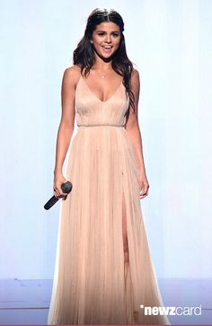 Selena Gomez performs onstage at the 2014 American Music Awards at Nokia Theatre L.A. Live on November 23, 2014 in Los Angeles, California. (Photo by Kevin Mazur/AMA2014/WireImage)