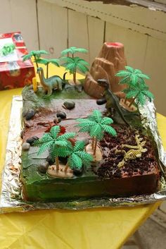 Dinosaur cake - Maybe could use green sugar sprinkled on chocolate frosting for a similar effect. The rock candies and cookie crumbles add nice detail. Kind of like this Branche except without the dino fossil portion, just dinos. Dinosaur Birthday Cakes, Dinosaur Cake, 4th Birthday Parties, Birthday Fun, Birthday Ideas, Rodjendanske Torte, Dino Cake, Party Cakes, Chocolate Frosting