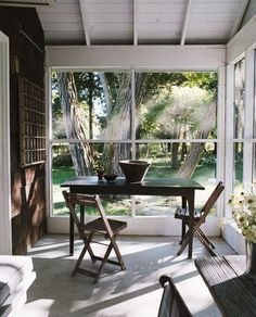 sun porch simple table with a few chairs. dark wood to match the floors in the rest of the house. Outdoor Rooms, Outdoor Tables, Outdoor Living, Outdoor Furniture Sets, Outdoor Decor, Red Cottage, Cottage Living, Living Room, Decks And Porches