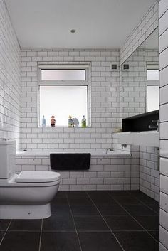 Floor to ceiling subway tiles with grey grouting