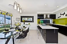 #Dining #room and #Kitchen #ideas from Ausbuild's Segal display #home.This room is bright and airy with a colour palette of white, black, and green. www.ausbuild.com.au