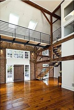 I love the contrast of the historical barn construction with modern functional elements.