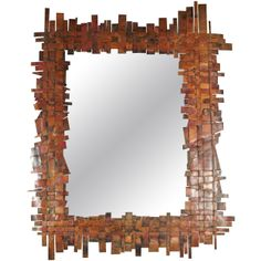 Great Brutalist mirror in the style of Curtis Jere | From a unique collection of antique and modern wall mirrors at http://www.1stdibs.com/furniture/mirrors/wall-mirrors/