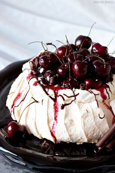 Tart red cherry compote with drizzled dark chocolate, and white chocolate shavings topped over a lightly sweetened, airy, merengue-like cake is the perfect treat.