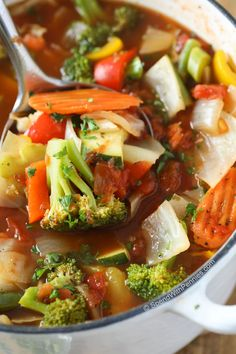 This Weight Loss Vegetable Soup Recipe is one of our favorites! Completely loaded with veggies and flavor and naturally low in fat and calories it's the perfect lunch, snack or starter! 0 Weight Watchers points and 21 day fix approved.