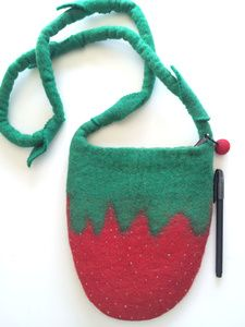 Check out the workmanship in this gorgeous felted bag. The little pips are all hand-sewen  beads (pips) and cute felt leaves on the shoulder strap.  There is a single zipped and lined compartment with a cute pom pom as the zip pull.  Dimensions: 24cm high and 21cm wide at the top tapering down as a strawberry does.
