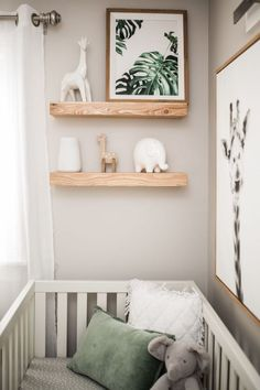 gender neutral safari nursery in black, white and wood tones and safari / jungle decor and giraffe print. Jungle leaves and fiddle leaf fig. Giraffe baby rocking horse for the home inspiration Austin's Room - Project Nursery
