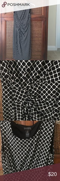 Black and white dress Flattering faux wrap dress made of polyester spandex. In very good condition. Dresses