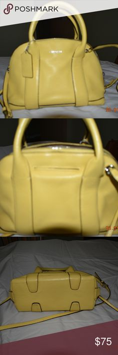 "Coach Handbag Gorgeous butter/sunshine yellow Coach leather bowling bag style purse.  Includes the crossbody strap. Two zippers open this bag up to make the contents completely accessible.  Inside there are two open pockets and the standard Coach zippered pocket.  Dimensions are: 10"" wide, 6.5"" tall and 4"" wide!  This is an amazing spring/summer color! Coach Bags"