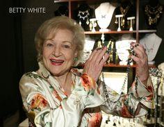Betty White holding Anne Koplik Jewelry