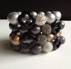 Sparkle Clover Bracelet - round vintage bead accented with pave crystal and black jade clover bead. $35.00, via Etsy.